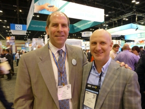 Health care business consultant David E. Williams, president of Health Business Group at HIMSS 2014 in Orlando with Ken Tarkoff, General Manager of RelayHealth